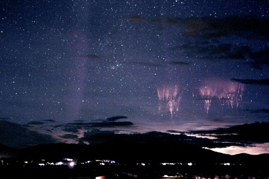 Dancing sprites, majestic emanations of light that flash for an instant high above the thunderheads, over Colorado. Image Credit: Thomas Ashcraft